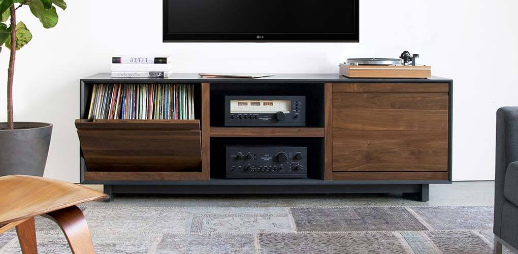AERO Walnut Storage Cabinet with swivel-style record storage panels and room for Hi-Fi network receiver, turntable, power speaker, and much more. Walnut North American hardwoods in a living room setting.