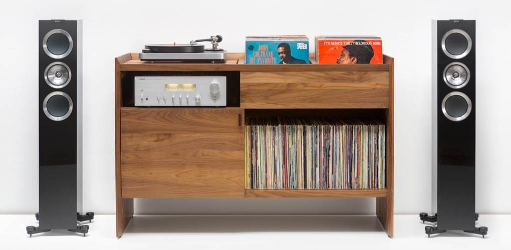 Unison Record Stand Dark Wood with KEF R500 and Modern Sleek tabletop turntable. Includes flip-style record storage and Hi-Fi audio network connector.