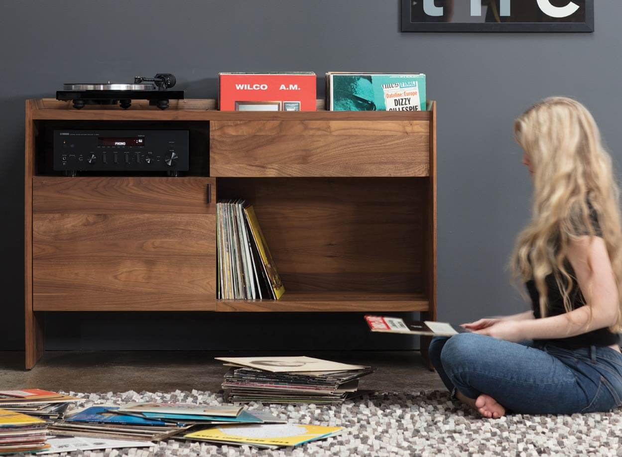 Unison Record Stand for LP Storage in living room setting with record displayed.